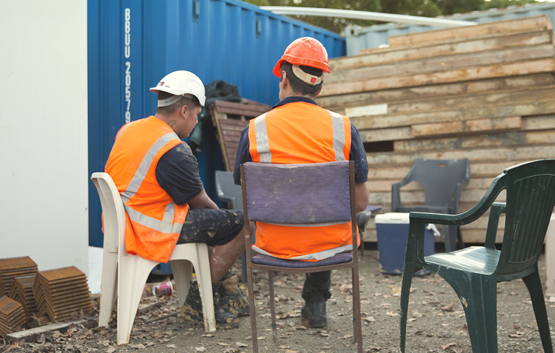 workmen talking to each other